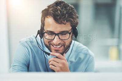 Buy stock photo Shot of a happy young man working in a call center