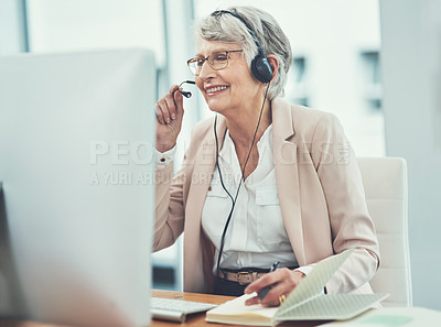Buy stock photo Shot of a happy senior woman working in a call center