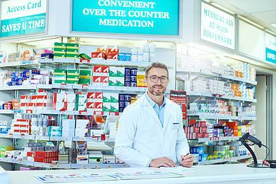 Buy stock photo Cropped portrait of a handsome mature male pharmacist working in a pharmacy