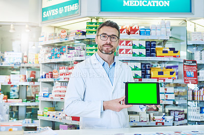 Buy stock photo Cropped portrait of a pharmacist holding up a tablet with a chromakey screen