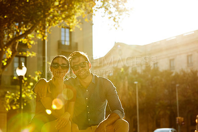 Buy stock photo Shot of a loving couple out in the city on a sunny day