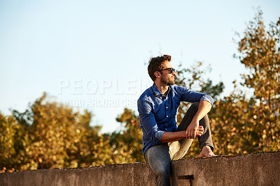 Buy stock photo Cropped shot of a man on a rooftop