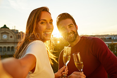 Buy stock photo Shot of a couple taking a selfie while out on a date
