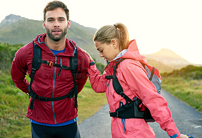 Buy stock photo Cropped shot of a young couple warming up before their morning run