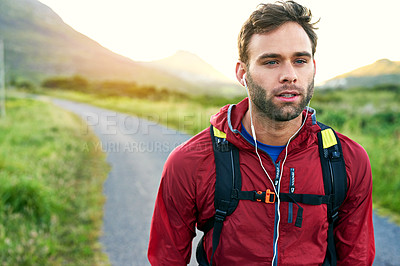 Buy stock photo Cropped shot of a handsome young male athlete out for a morning run