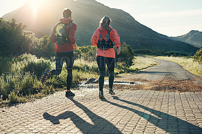 Buy stock photo Rearview shot of an unrecognizable young couple out for a morning run