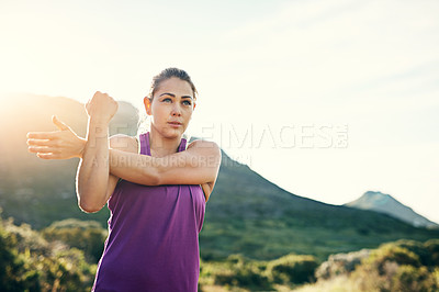 Buy stock photo Cropped shot of an attractive young female athlete stretching before her morning run