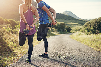 Buy stock photo Rearview shot of an unrecognizable young couple warming up before their morning run