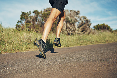 Buy stock photo Cropped shot of an unrecognizable young man out for his morning run