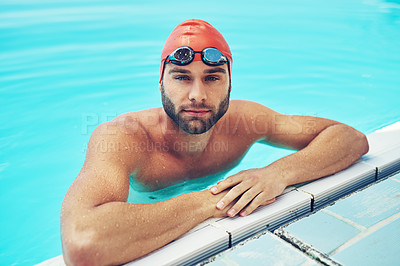 Buy stock photo High angle portrait of a handsome young male swimmer chilling in the swimming pool