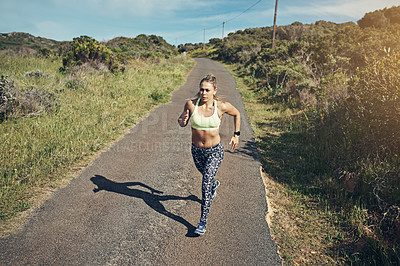 Buy stock photo High angle shot of an attractive young female athlete out for a morning run