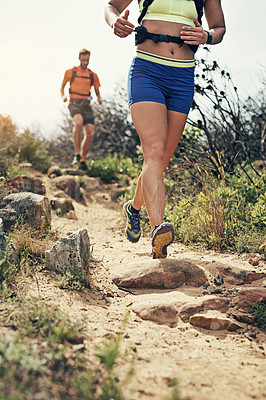 Buy stock photo Low angle shot of a young athletic couple out for their morning run