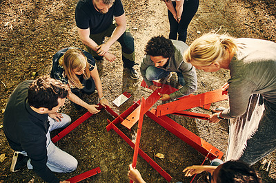 Buy stock photo High angle shot of a group of diverse colleagues team building at a company retreat