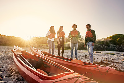 Buy stock photo Cropped shot of a group of diverse colleagues canoeing as part of their company's team building retreat