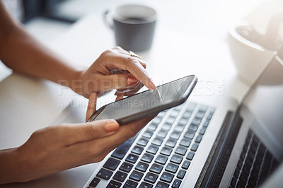 Buy stock photo Closeup shot of an unrecognizable female designer using a cellphone in her home office