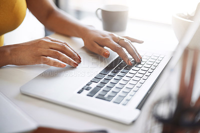 Buy stock photo Closeup shot of an unrecognizable female designer using a laptop in her home office