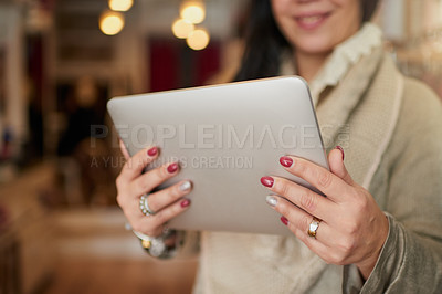 Buy stock photo Closeup shot of a digital tablet in the hands of a female boutique owner