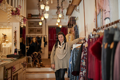 Buy stock photo Cropped portrait of an attractive mature female entrepreneur standing in her self-owned boutique