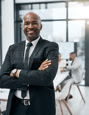 Buy stock photo Portrait of a confident mature businessman in a boardroom with his colleagues in the background