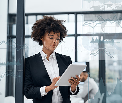 Buy stock photo Shot of a young businesswoman using a digital tablet in a boardroom with cgi graphs superimposed against her
