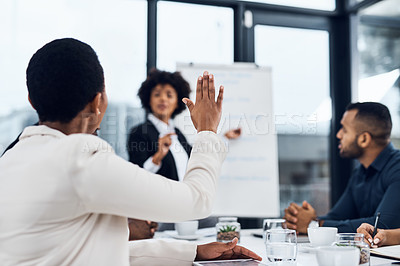 Buy stock photo Shot of a businesswoman raising her hand to ask a question during a presentation in the boardroom