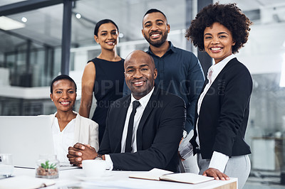 Buy stock photo Shot of a group of businesspeople using a laptop together in a modern office
