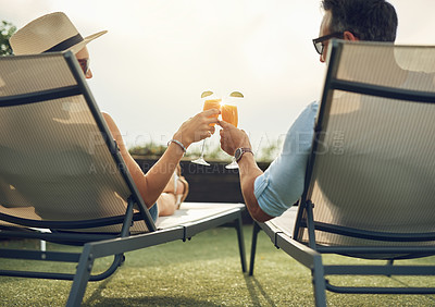 Buy stock photo Rearview shot of an affectionate mature couple toasting while relaxing outdoors