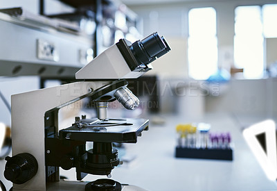 Buy stock photo Shot of a microscope in a laboratory