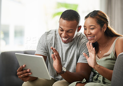 Buy stock photo Cropped shot of an affectionate young couple using their tablet to video chat