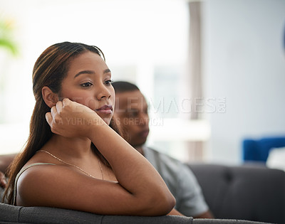 Buy stock photo Cropped shot of a young woman giving her boyfriend the silent treatment after a fight