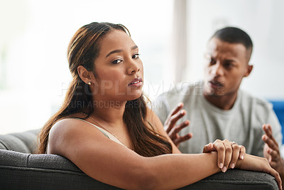 Buy stock photo Cropped portrait of a young woman giving her boyfriend the silent treatment after a fight