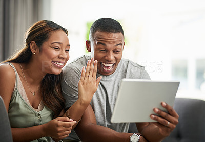 Buy stock photo Cropped shot of an affectionate young couple announcing their engagement over video chat