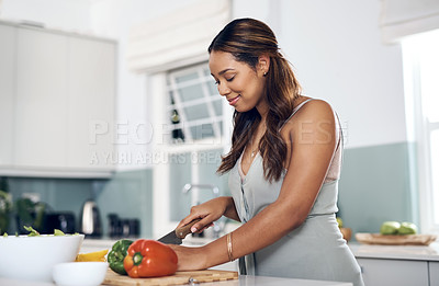 Buy stock photo Shot of a young woman cooking at home