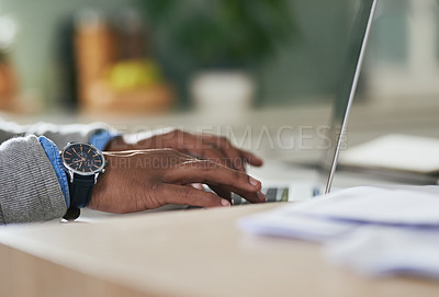 Buy stock photo Closeup shot of an unrecognizable man using a laptop at home