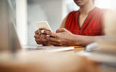 Buy stock photo Cropped shot of an unrecognizable businesswoman using a cellphone in her home office