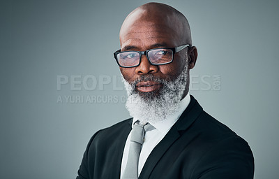 Buy stock photo Studio portrait of a mature businessman posing against a grey background