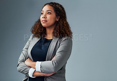 Buy stock photo Studio shot of a young businesswoman posing against a grey background