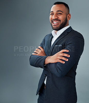 Buy stock photo Studio shot of a young businessman posing against a grey background