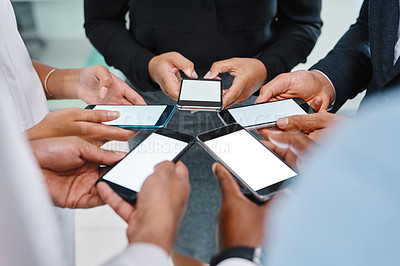 Buy stock photo High angle shot of a group of unrecognizable businesspeople using cellphones while standing in their office lobby