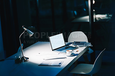 Buy stock photo Shot of a laptop on a desk in a modern office at night with no people