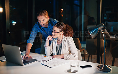 Buy stock photo Cropped shot of young attractive colleagues working late at the office