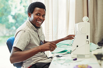 Buy stock photo Cropped shot of a fashion designer using a sewing machine in a workshop