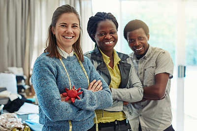 Buy stock photo Portrait of a group of dressmakers at work