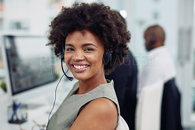 Buy stock photo Portrait of a call centre agent working in an office with her colleagues in the background