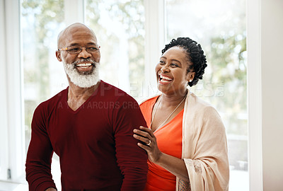 Buy stock photo Shot of a happy mature couple sharing an affectionate moment at home