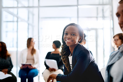 Buy stock photo Portrait of a happy young businesswoman attending a conference