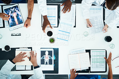 Buy stock photo High angle shot of an unrecognizable medical team having a meeting in the hospital boardroom