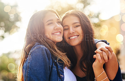 Buy stock photo Cropped shot of two female best friends hanging out in the city