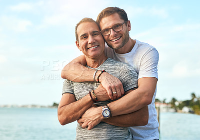 Buy stock photo Portrait of an affectionate mature couple spending the day by the beach