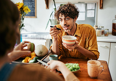 Buy stock photo Cropped shot of a young man having breakfast